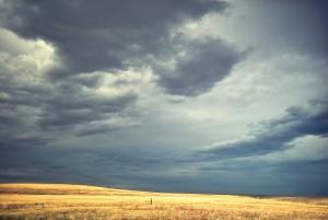 Dark Clouds Behind Rolling Hills
