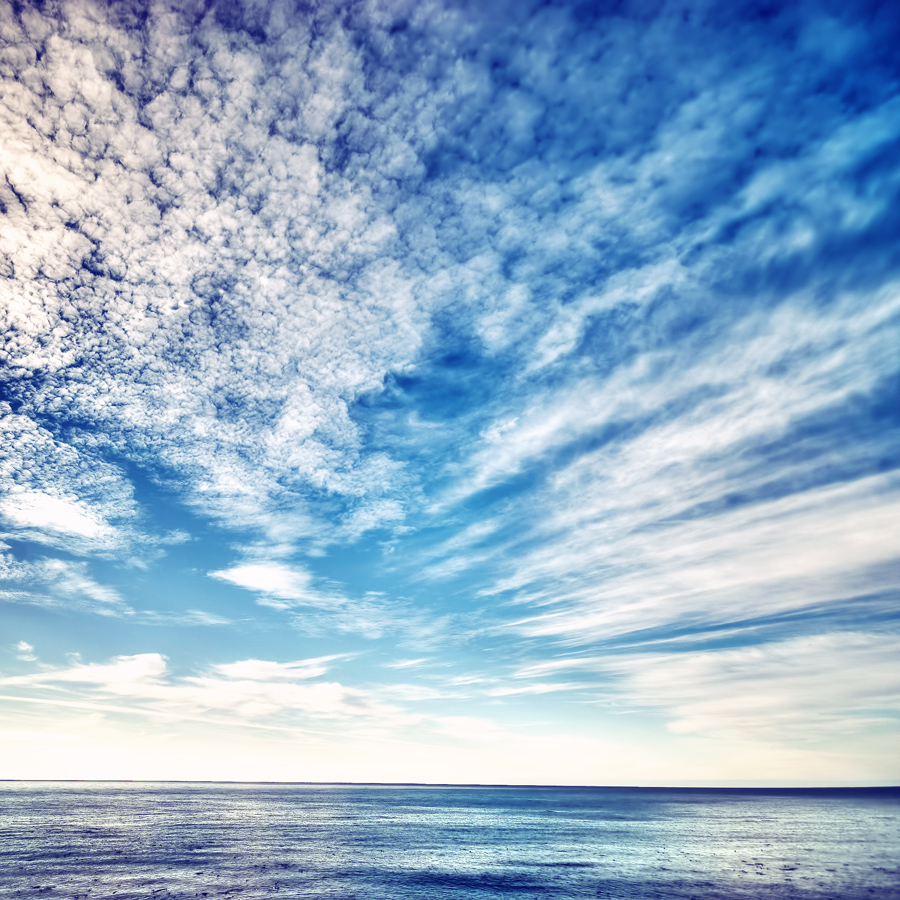 Dramatic clouds over blue ocean