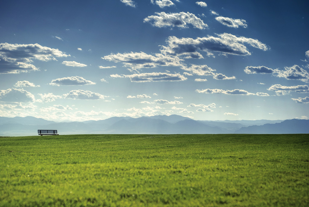 Blue Sky and Green Grass overlooking mountains