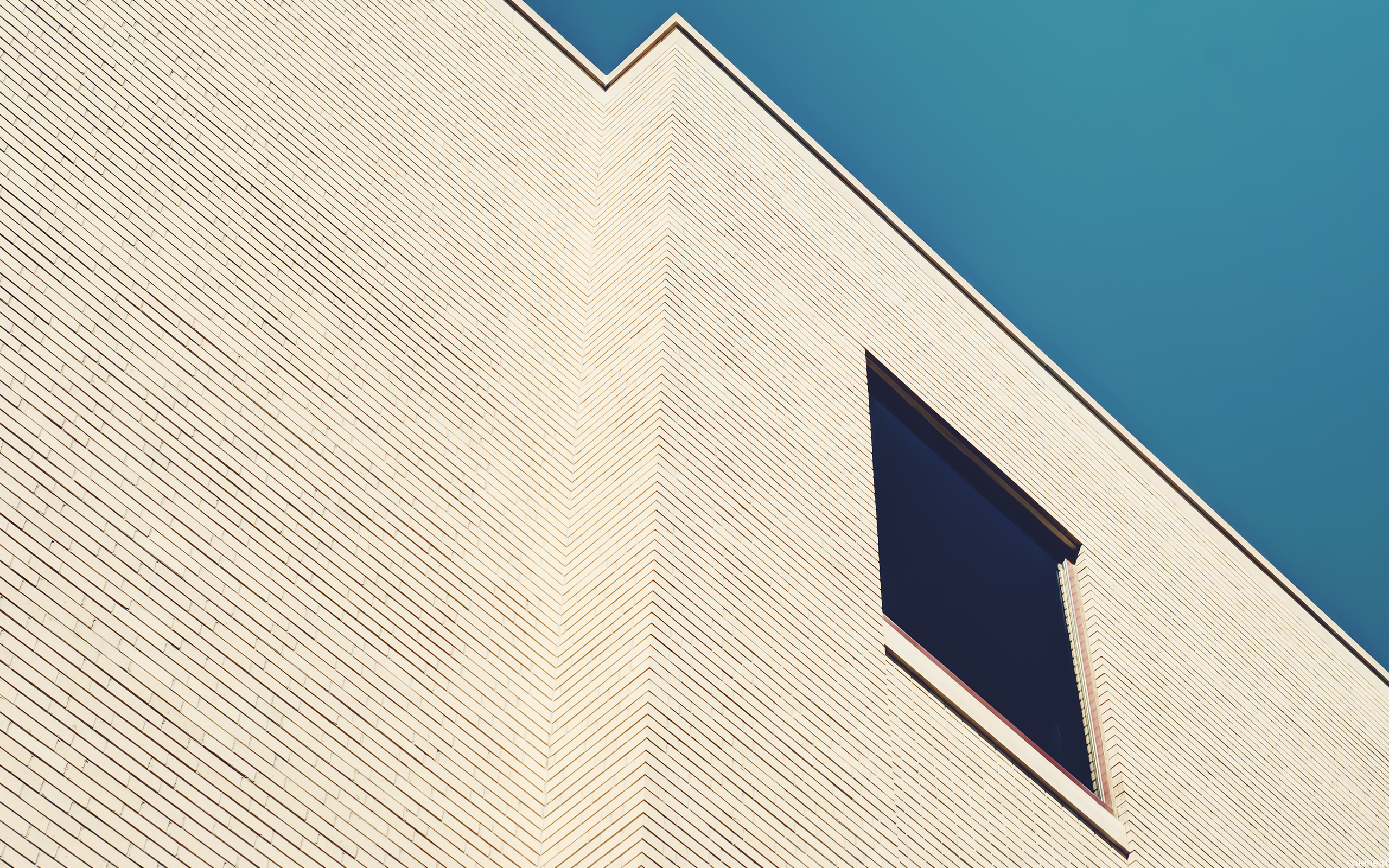 beige building with blue sky