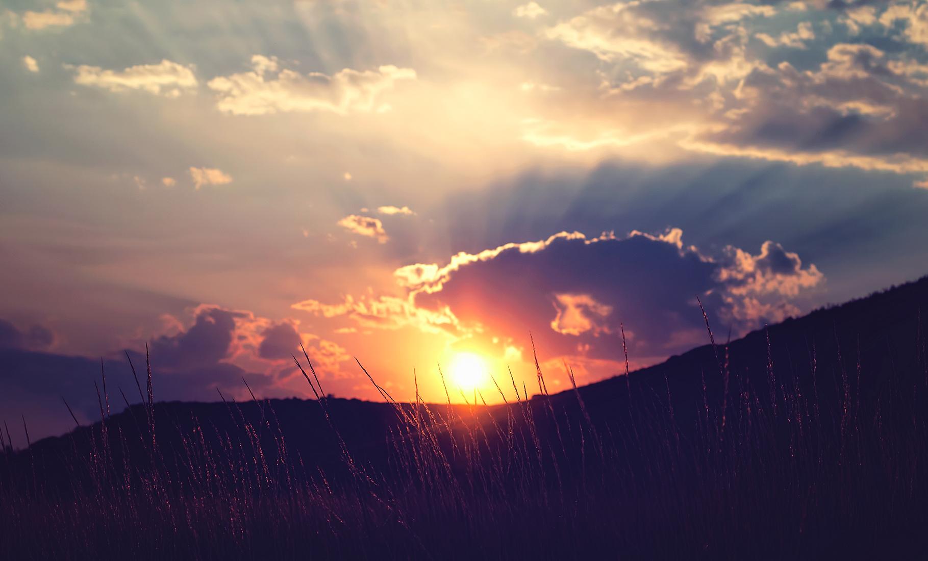Sunset Behind a Hill