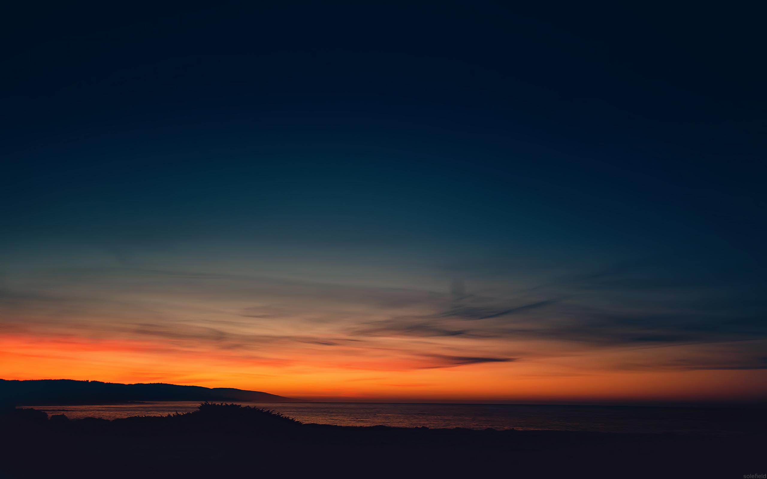 Orange Sunrise over Dark Ocean