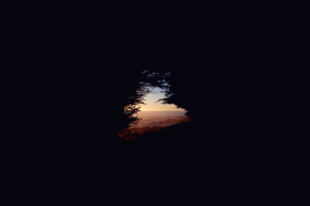 Ocean through window of darkeness