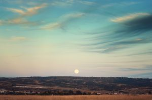 Moonrise over plains