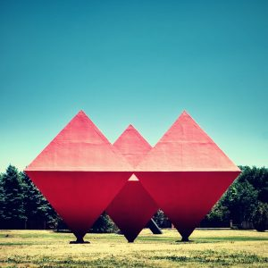 Pink Statues Triangle Cubes