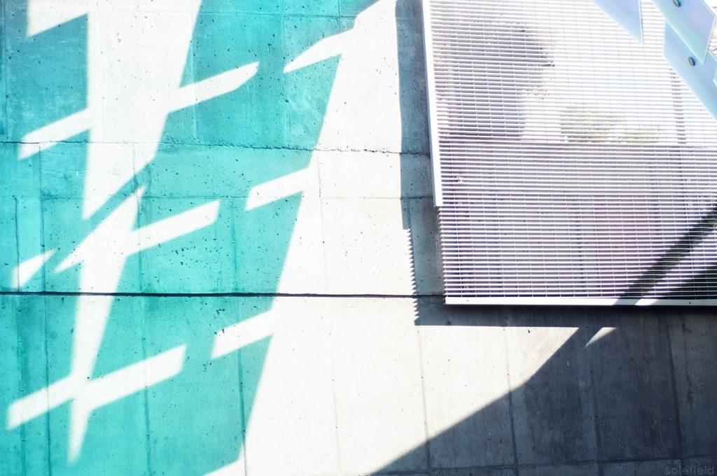 Blue Light Shining on Grey Wall