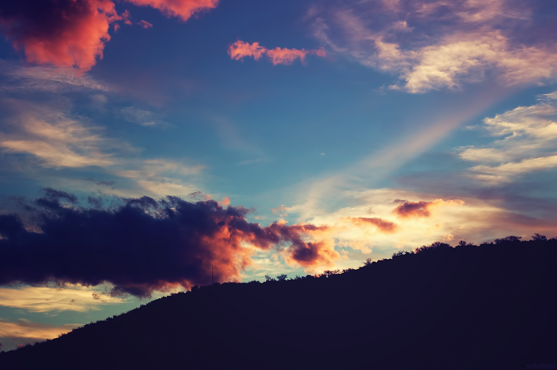 Pink & Blue Sunset Behind an Hill