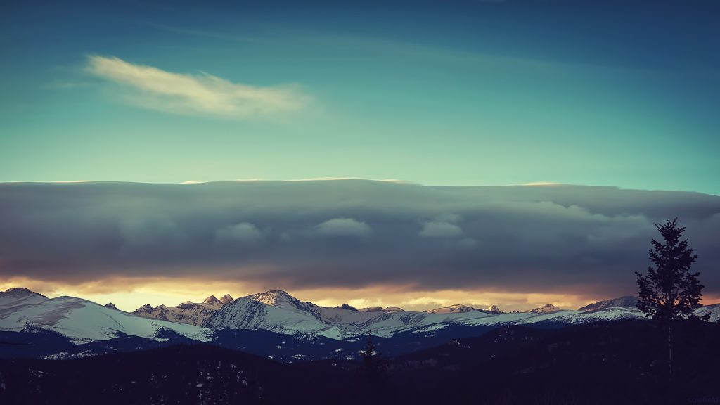 Blue Sunset Over Snowcapped Mountains