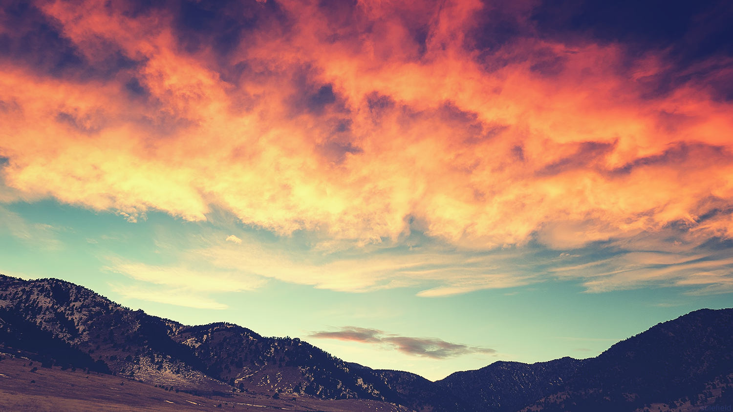 Dramatic Pink Sunset Clouds Over Mountains
