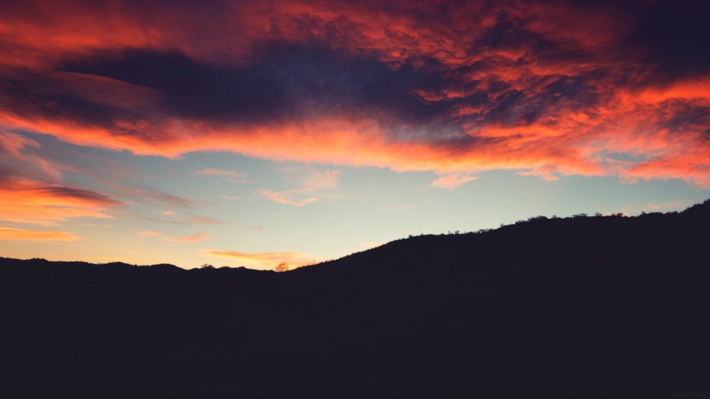 Pink sunset over hills in Colorado