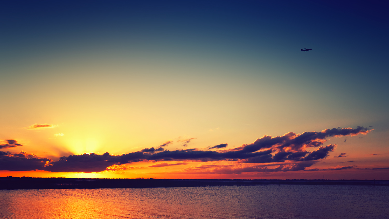 Yellow Sunset with airplane flying overhead