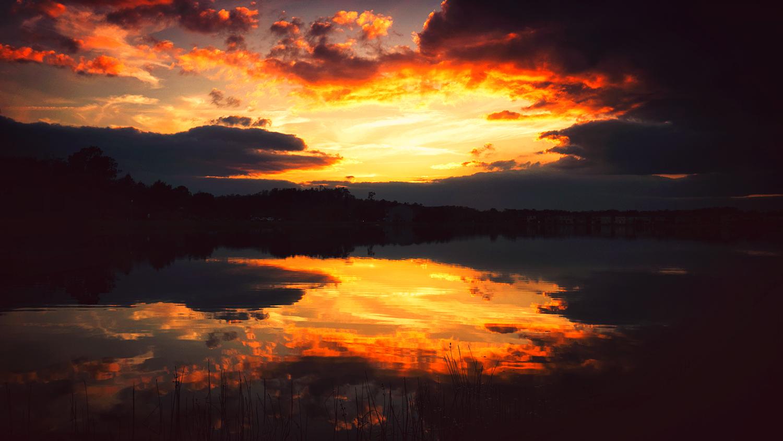Dark sunset reflection in lake